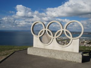 The Olympic Rings in Portland Limestone, overlooking Chesil Beach