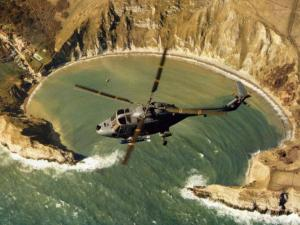 Lynx helicopter over Lulworth Cove