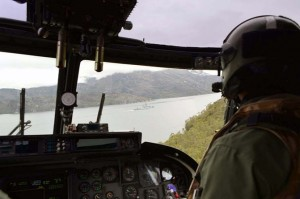 HMS Portland's Lynx flies over the Patagona canals